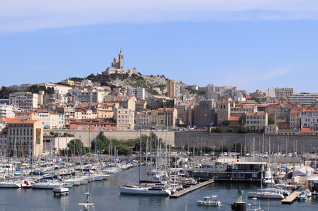Old harbour in Marseille with Notre Dame de La Garde in the far background